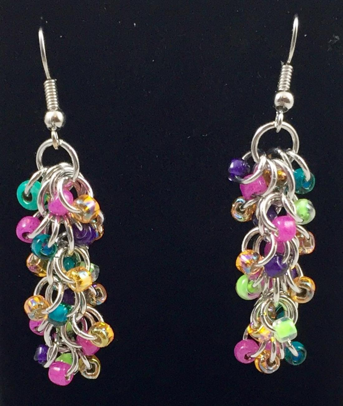 Loops of crystal seed beads on silver rings